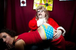 18 Trust Seattle 2011 Kryptonite Nick as Santa spanks Jade Owen photo by Sarah Lovrien
