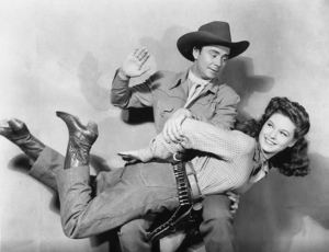 Russell Hayden spanks Shirley Patterson in The Vigilantes Ride (1943)