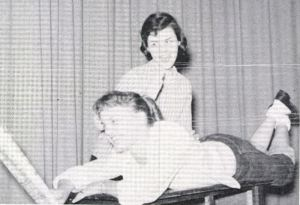 Dian Hopkins pommels Dolly Dollins at Fort Worth, Texas, in the school year 1958-59
