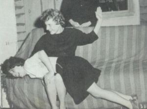 Ruth Mayes spanks Nedra Whittle at Oakley High School, Idaho, on April 19, 1962