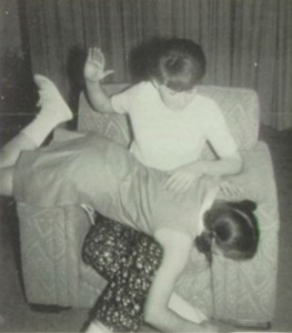 Linda Howell is spanked by Diana Brown at Lucas Luray High School, Kansas, on April 21, 1967